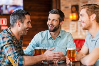 3 men having drinks